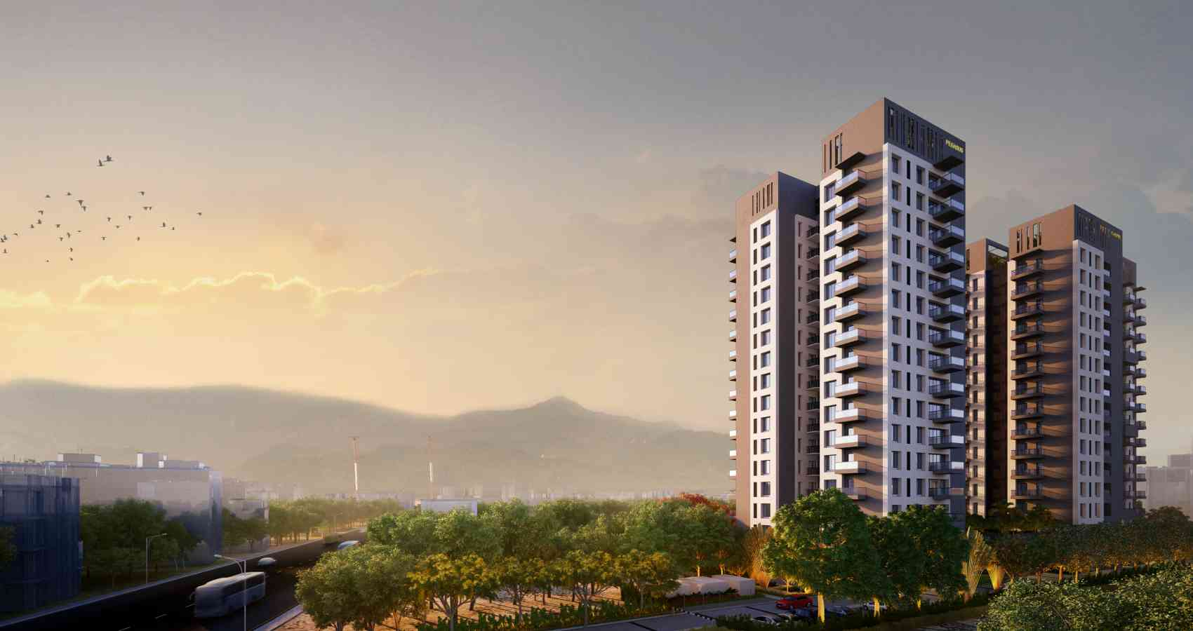 Tall residential structure of Darpan 88° near the highway during evening with the glimpses of sunset in the hills